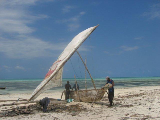 Zanzibar - fishermen working on a dhow