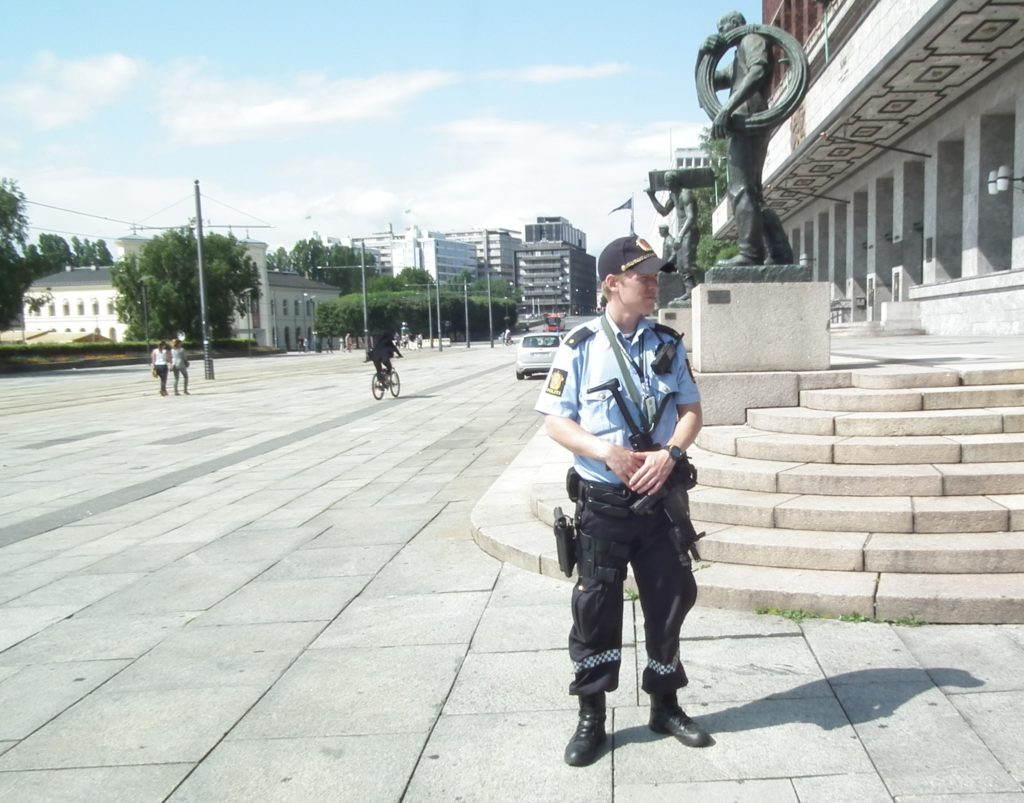 Day after Breivik attacked: Armed police in front of the Oslo City Hall