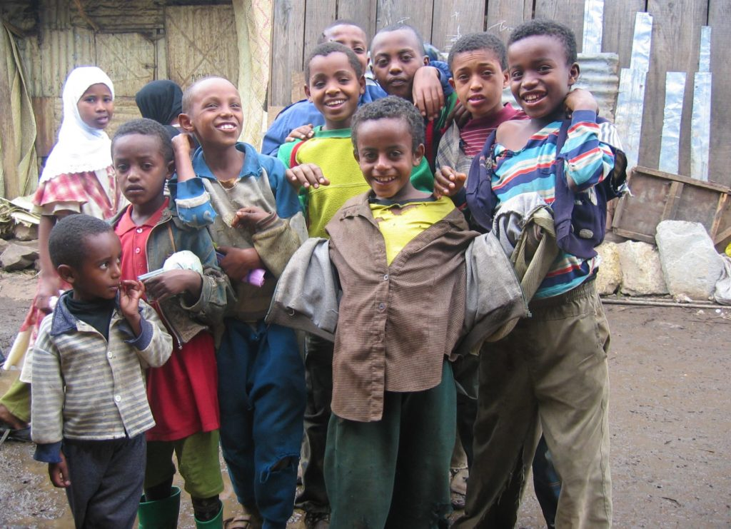 Addis Ababa - Kids at Mercado.  When they saw my camera, these kids scrambled to be photographed