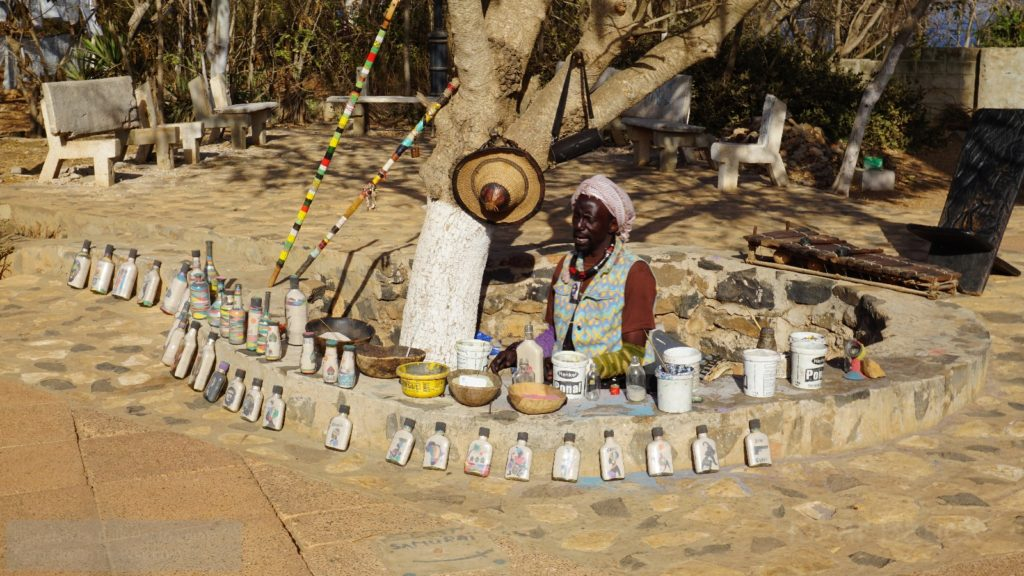The Bottle Artist of Ile de Goree.  This gentleman specializes in sand images inside bottles. He has a wide variety readily available, and is happy to make a customized on demand