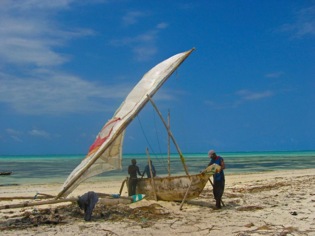 Jambiani - fishermen working on a dhow