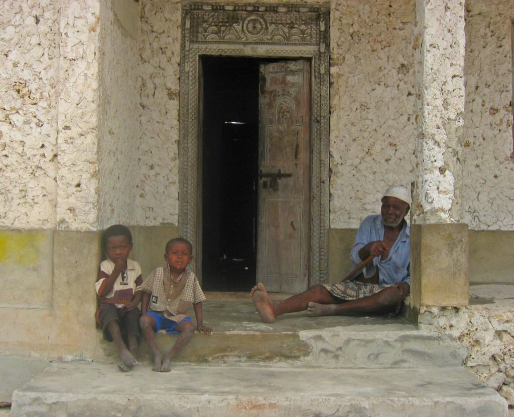 People in front of their house in Jambiani Village