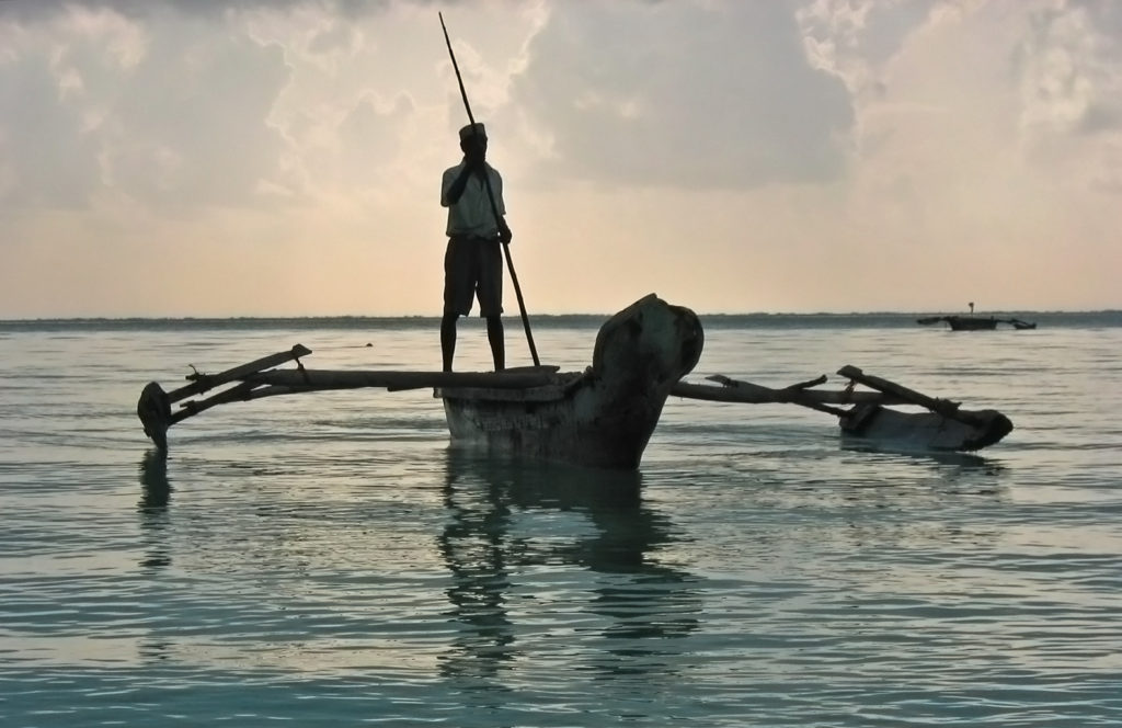 Jambiani, Zanzibar- fisherman on a dhow in the early morning