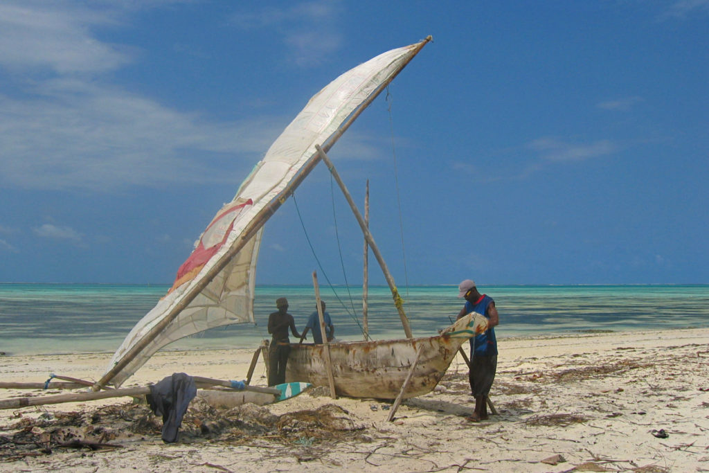 Jambiani – fishermen working on a dhow