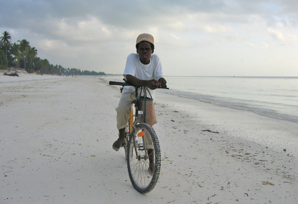 Jambiani – A boy on his bike, up before sunset to buy fish from the local fishermen
