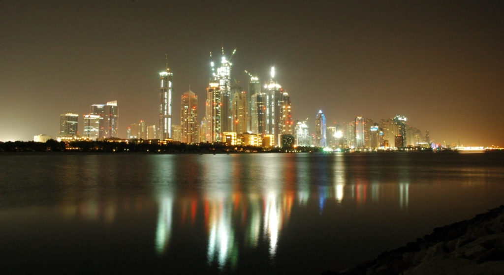 Dubai by night - reflection of skyscrapers in the water