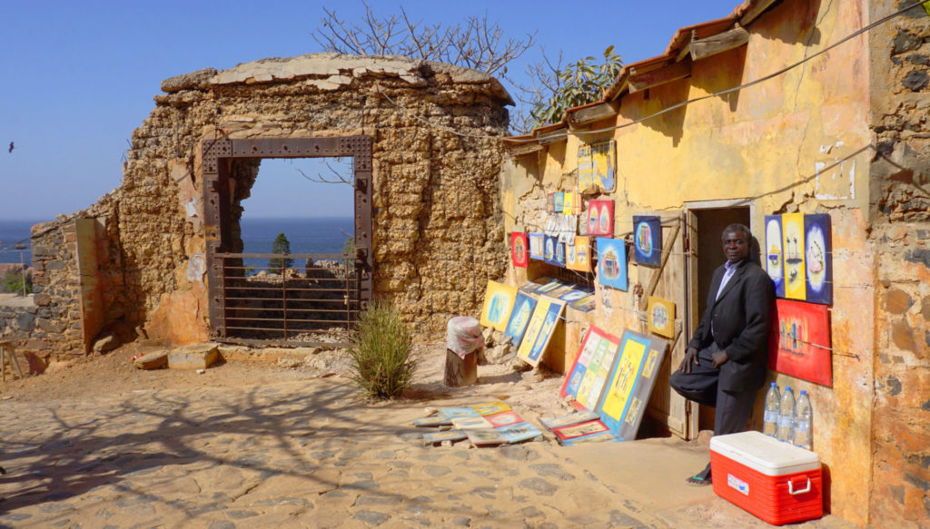 Ile de Goree - An artist displaying his works near the top of the hill